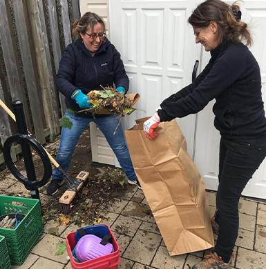 Picture of two volunteer doing gardening